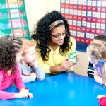 Teacher playing cards with children