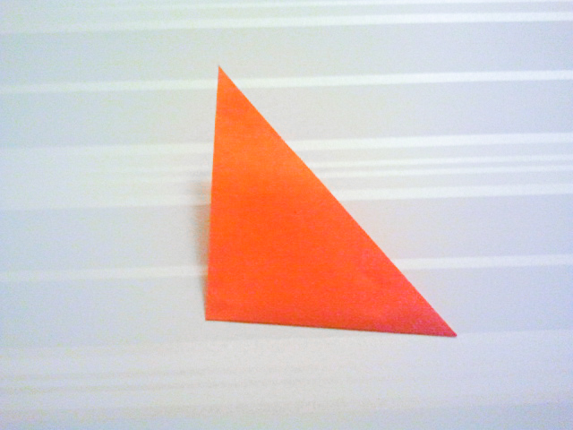 Fold paper again to make a smaller triangle.