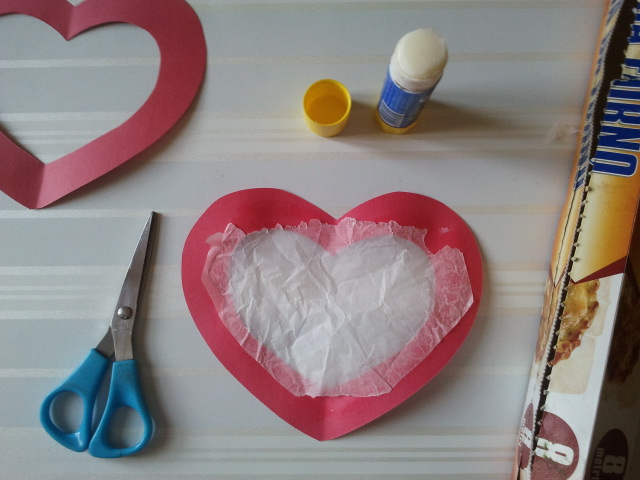 Step 3: Glue a piece of wax paper (also known as oven paper) inside the small heart.