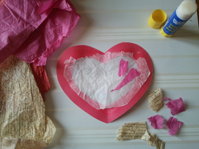 Step 4: Tear pieces of tissue paper and glue them onto the wax paper.