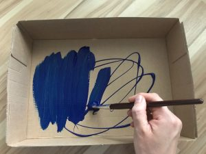 Paint the inside of your box blue.