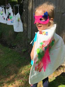 Child in Superhero Cape