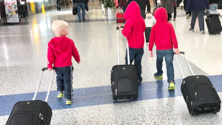 Three Children at Airport