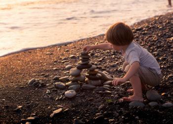 Child Stacking Rocks